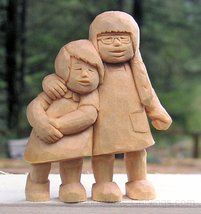 sisters wood carving